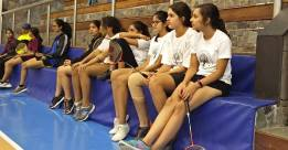 Girls await their turn to play for the tournament